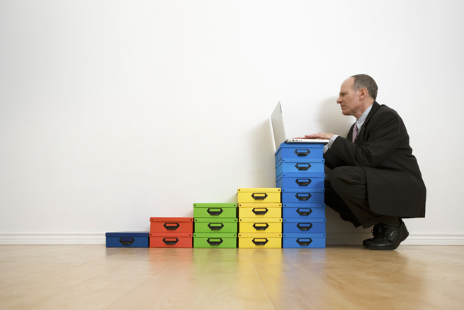 Frustrated man with laptop and boxes